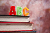 Close up of the alphabet abc in front of the book — Stock Photo