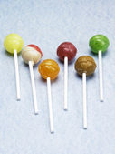 Few lollipop on the blue texture background — Stock Photo