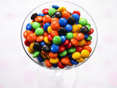 A cup of multi color chocolate candy — Stock Photo