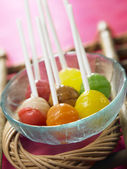 Bunch of the lollipops on the bowl — Stock Photo