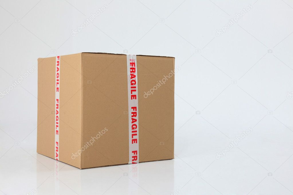 Brown cardboard box sealed with fragile sign  Stock Photo #9159634