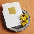 Invitation card on the tray with flower — Stock Photo