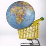 Globe in the shopping cart — Stock Photo