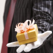 Mshowing happy birthday present — Stock Photo #9187931