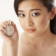 Young woman holding a stop watch — Stock Photo