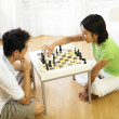 Stock Photo: Couple playing chess at home
