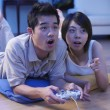 Couple playing tv game at home — Stock Photo #9188695