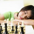 Young woman thinkin of her next move — Stock Photo