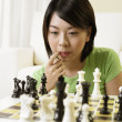Stock Photo: Young womthinkin of her next move
