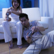 Couple playing tv game at home — Stock Photo