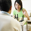 Stock Photo: Couple challanging each other in chess game