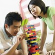Couple playing stack wood stick game — Stock Photo