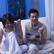 Couple gets excited while watching tv — 图库照片