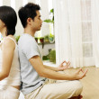 Couple practising yoga together — Stock Photo