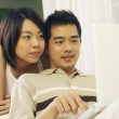 Couple is surfing the internet together — Stock Photo