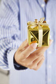 Man hand with present — Stock Photo