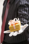 Man showing the happy birthday present — Stock Photo