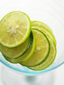 Slices of limes — Stock Photo