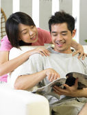 Young man being massage by his spouse — Stock Photo