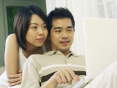 Couple is surfing the internet togehter — Stock Photo