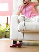 Young woman having conversation on the phone — Stock Photo