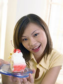 Young lady savouring a piece of cake — Foto de Stock