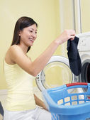 Woman in front of washing machine — Stock Photo