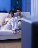Couple gets sad while watching tv — Stock Photo