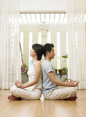 Couple practising yoga together — Stock Photo