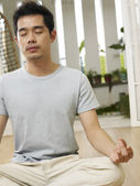 Man in his yoga position — Stock Photo