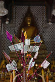 Thailand, Bangkok, local money (bahts) donated in a Buddhist temple — Стоковое фото