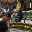 Stock Photo: Thailand, Bangkok, Chinatown District, Yaowarat Road, Traimitwitthayaram Temple (Wat Traimit), a Thai girl is praying in front of Buddha statues