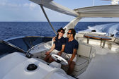 Italy, Tuscany, Elba Island, luxury yacht Azimut 75, couple — Stock Photo