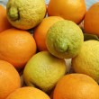 Italy, sicilian oranges and lemons on a decorated dish — Foto Stock