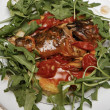 Italian appetizer with bread, garlic, fish, mussels, tomatoes - Stok fotoğraf