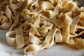 Italian fresh homemade pasta (tagliatelle) — Stock Photo