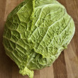Savoy cabbage on a wooden table - ストック写真