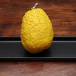 Citron (Citrus medica) on a wooden table — Stock Photo
