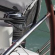 Cruising on a sailing boat, winch and steering wheel - Стоковая фотография