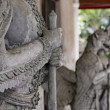 Thailand, Bangkok, Amarintharam Worawihan Temple, sacred statues at the entrance — ストック写真