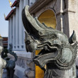 Thailand, Bangkok, Pranon Wat Pho, laying Buddha temple, stone dragon statues — Stock Photo