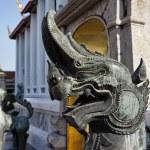 Thailand, Bangkok, Pranon Wat Pho, laying Buddha temple, stone dragon statues — Stock Photo