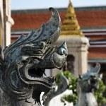 Thailand, Bangkok, Pranon Wat Pho, laying Buddha temple, stone dragon statues — Stock Photo #9907432