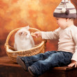 Happy baby boy with a kitten - Stock Photo