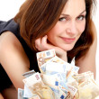 Woman with lots of money — Stock Photo
