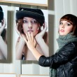 Model posing in front of a showcase — Stock Photo #9872864