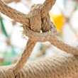 Gray ropes tied together - Stock Photo