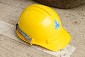 Yellow helmet. The background is white Description:Yellow helmet. The backg — Stockfoto