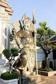 Statue of Man at Wat Pho in Bangkok — Stock Photo