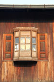 The windows are dark brown wood — Stock Photo